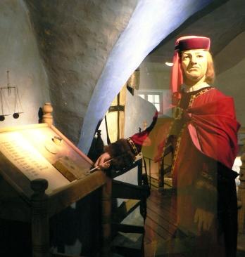 Henrik Wulff (?) vid skrivpulpeten.