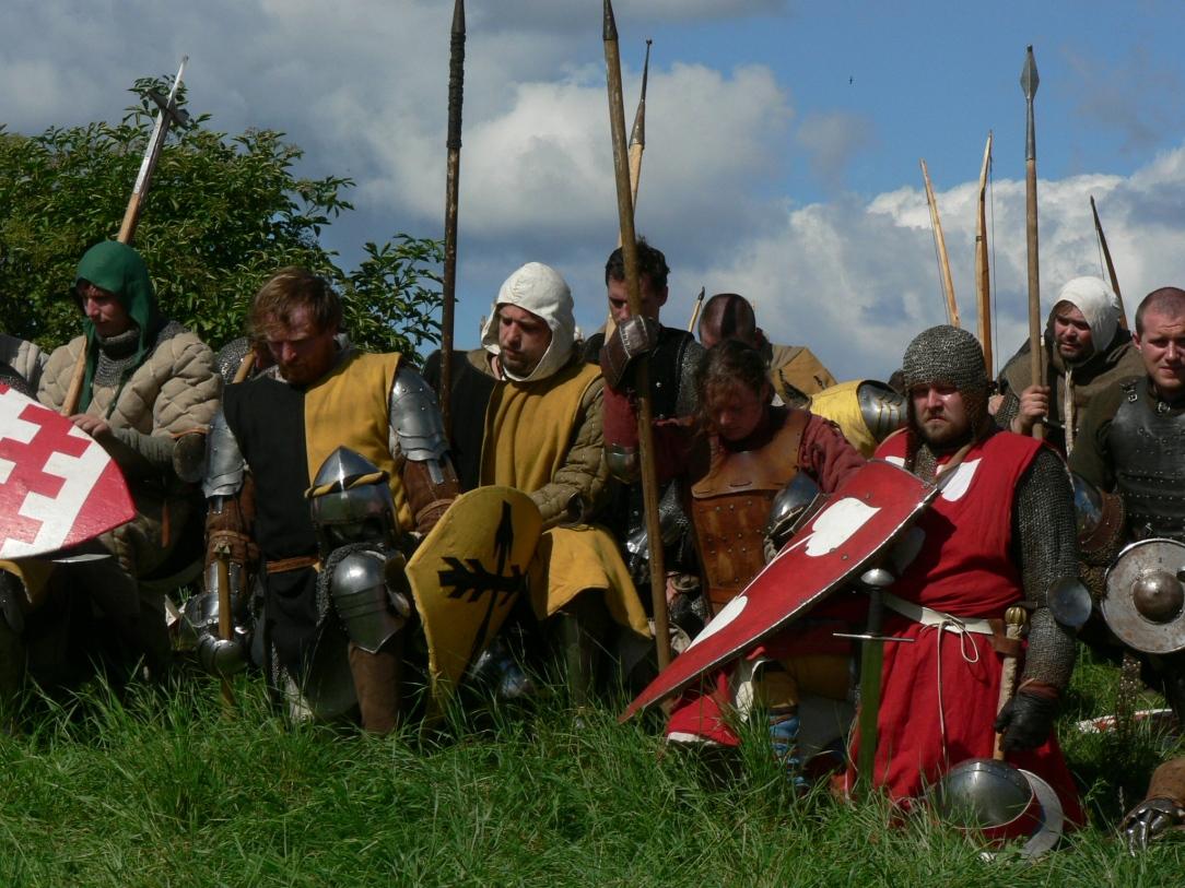 Segrarna ber en bön för de besegrade.